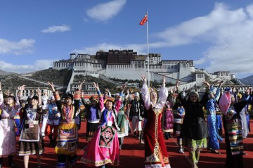 """ethnic minorities"" performing infront of the Potala, Lhasa, Tibet"