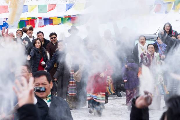 Tibetans partake in sangsol during the 3rd day of Losar in MN, 2014.