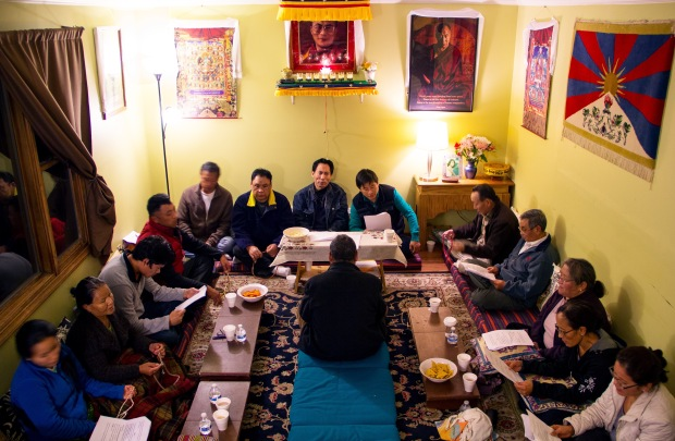 Members of Amherst Regional Tibetan Association (ARTA) participate in a religious event. Although the Tibetan community in Amherst is small and scattered, they gather for community prayer once a month.